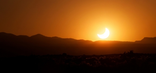 The crescent Sun sets behind mountains outside of Albuquerque, NM near the end of the May 2012 annular eclipse.