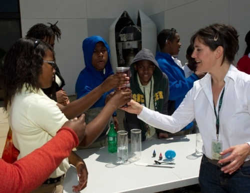 Valerie helping students with hands-on ocean experiments at the Goddard Visitor Center during Beautiful Earth event, April 19, 2012.